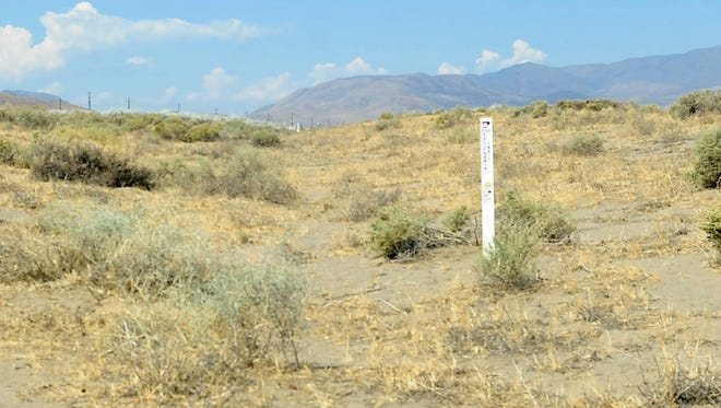 Signage marks the Fernley Swales, depressions formed by thousands of wagons that traveled along the Emigrant Trail.