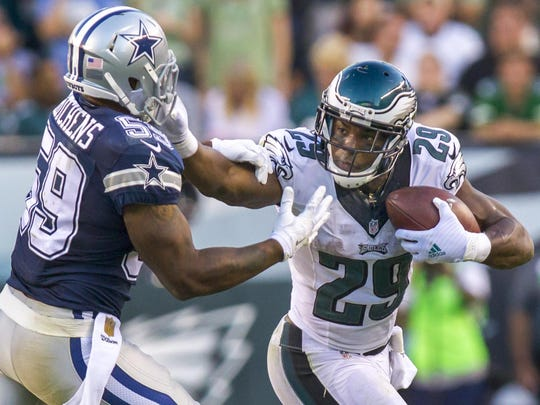 Eagles running back DeMarco Murray stiff arms Cowboys linebacker Anthony Hitchens during the Eagles 20-10 loss to the Dallas Cowboys in Philadelphia on Sunday afternoon.