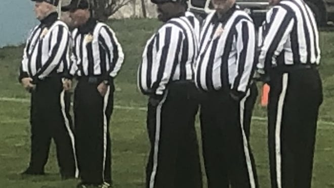 Referees are pictured at a 2020 playoff contest. It was a much different group from the volunteers assembled to referee a 1958 contest between Ridgeley and Circleville.
