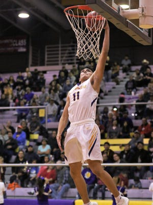 ​Kirtland Central's Terrin Willie goes up for a breakaway layup against Miyamura Tuesday at Bronco Arena. Willie is more proactive this season as an inside scorer.