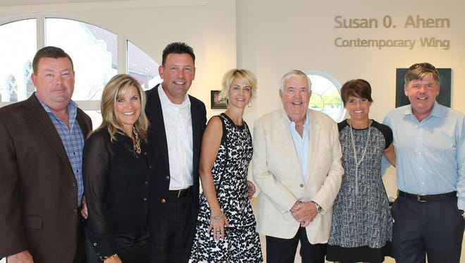 Members of the Ahern family pose by the name of Susan O. Ahern, for which the Thelma Sadoff Center for the Arts' Contemporary Wing was recently named. From left are: Tony Ahern and his wife, Linda, Tim Ahern and his wife, Rose, John Ahern, Colleen Ahern and her husband, Tripp.