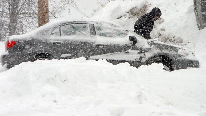 A driver checks his stuck car.