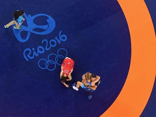 Helen Louise Maroulis celebrates after defeating Saori Yoshida of Japan during the Women's Freestyle 53 kg Gold medal match.