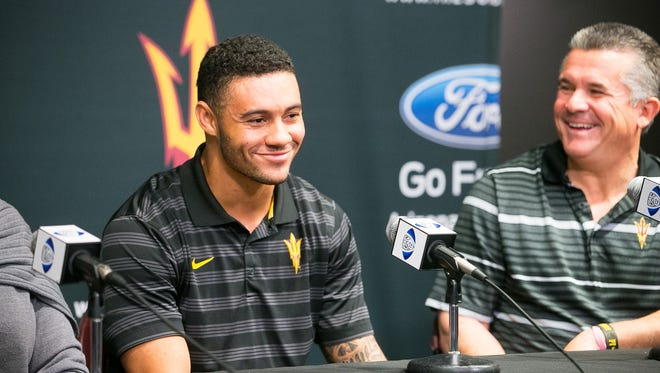 ASU football player D.J. Foster announces his return for his senior season with head coach Todd Graham at the Carson Student-Athlete Center in Tempe on Dec. 30, 2014.