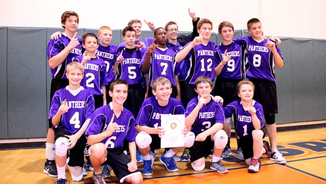 The boys Cypress Lake volleyball team poses after winning the Lee County Middle School Volleyball Championship Monday night.