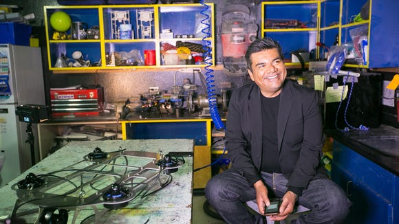 """Actor George Lopez sits in the Carl Hayden High robotics lab after a screening of the movie """"Spare Parts"""" based on the winning robotics team at the Carl Hayden auditorium in Phoenix on Tuesday, January 6, 2014."""