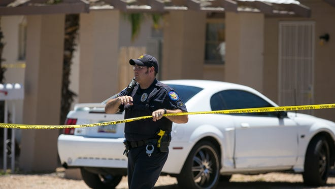 Phoenix Police Officers at the scene of a shooting in north Phoenix on Monday, July 6, 2015.