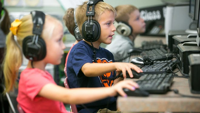 Henry Honcharevich, 6, uses a computer during class at Sierra Verde School in Glendale in September 2015. The Deer Valley Unified School District seeks an override this fall to maintain full-day kindergarten and other programs. The district is among 28 in Maricopa County with funding requests before voters.