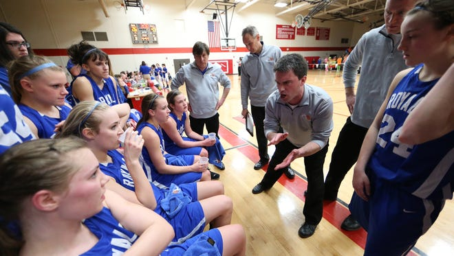Assumption girls basketball coach Joe Birkhauser, center, has stepped down from his post after 20 years with the program.