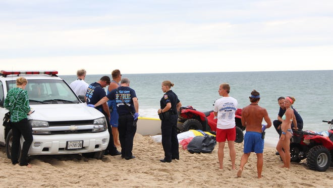 Responders gather on the beach near 127th street in Ocean City at the site where a body washed ashore on Tuesday, August 9, 2016.