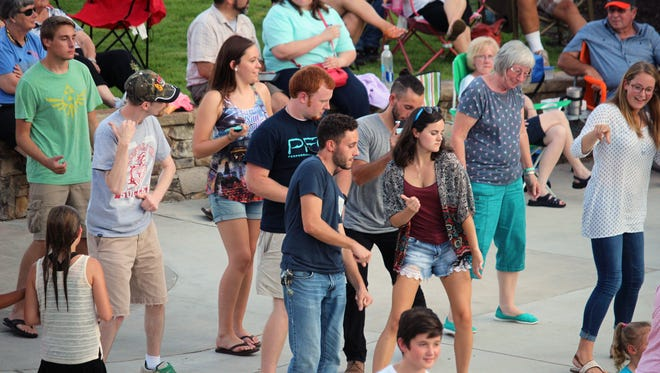 People dance during this year's final Piedmont Natural Gas Block Party at Carolina Wren Park in downtown Anderson.