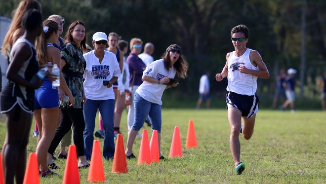 Estero senior Arye Beck races down the final stretch during Thursday morning's District 3A-12 meet at Palmetto Ridge High School in Naples, Florida. Estero, Naples, Gulf Coast and Barron Collier will advance to next week's regional championship.
