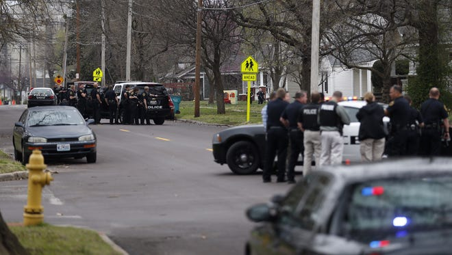 Police surround a home in the 1400 block of North Broadway Avenue on Tuesday afternoon.