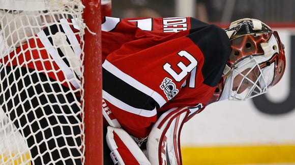 New Jersey Devils goalie Cory Schneider (35) reacts during the third period of an NHL hockey game against the Columbus Blue Jackets, Sunday, March 19, 2017, in Newark, N.J. The Blue Jackets defeated the Devils 4-1. (AP Photo/Adam Hunger)
