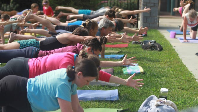 Yoga in the Park in downtown Asheville is a donation-based event on summer Saturdays.