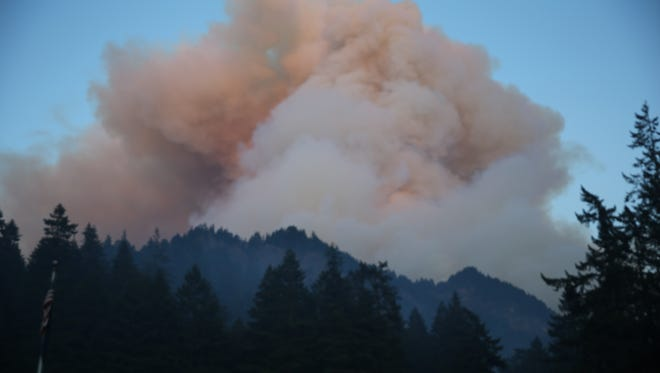 Fire burns in the Eagle Creek area of Columbia River Gorge, Saturday, Sept. 2, 2017.  Officials reported that they had rescued six hikers Sunday morning, who were among about 140 forced to spend the night outside near Tunnel Falls after a fire broke out near the popular Columbia River Gorge trail about 90 miles east of Portland. (Mark Graves/The Oregonian via AP)