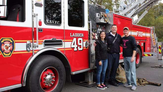 Kangaroo Kids Director Lisa Mirra, Firefighter Kevin Calvo, Assistant Director Shaun Pidany.