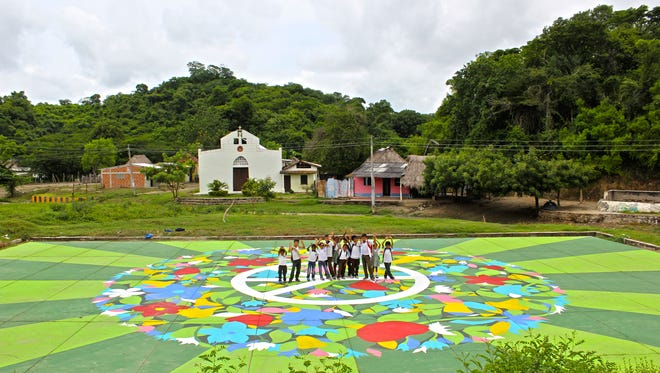 Non-profit ARTISTLOVE and Fundación Divergente worked with the town of El Salado, Colombia, to paint a mural on the site of a 2000 massacre.