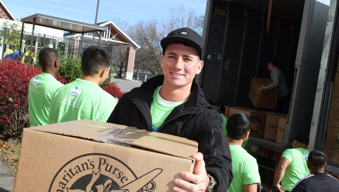Members of BOSS (Better Opportunities for Single Soldiers) at Fort Campbell came out to assist Operation Christmas Child with truckloads of items that were being dropped off at Cumberland Presbyterian Church in Clarksville on Monday.