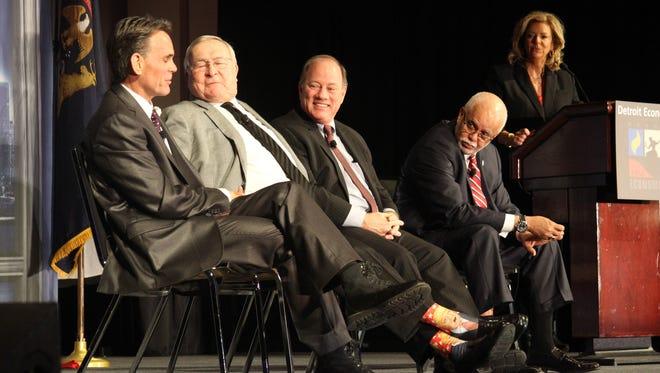 From left, Mark Hackel, L. Brooks Patterson, Mike Duggan and Warren Evans with moderator Carol Cain at the Detroit Economic Club's 2017 Big Four annual luncheon.