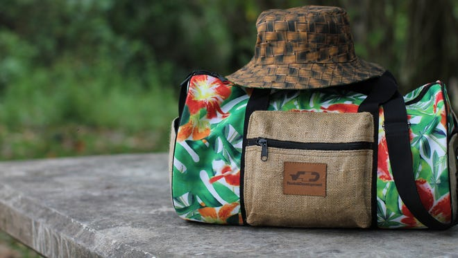 Roots and Development tuhong bucket hat and floral duffel bag.