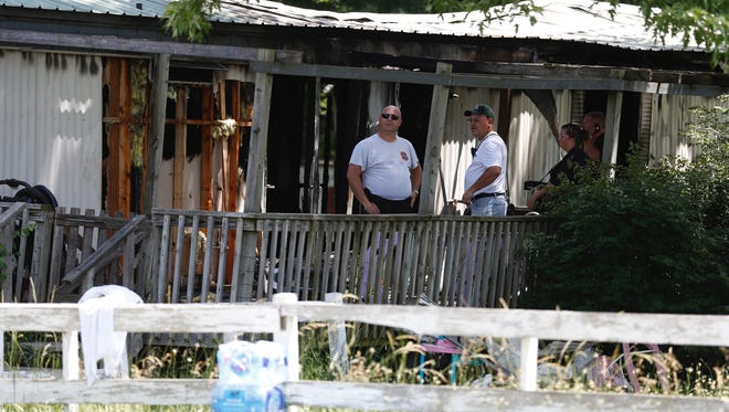 Officials on the scene of a fatal fire in Lebanon.