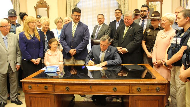 Gov. John Carney on Tuesday signed the Public Safety Immunity Bill which extends legal protection to emergency responders in Delaware who use overdose drugs, such as Narcan, in an effort to save lives.