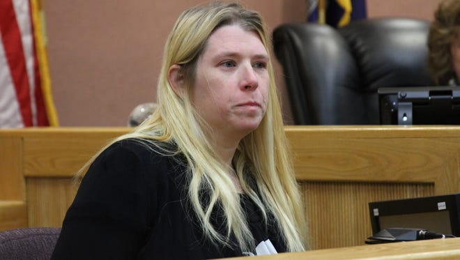 Amy Flemming tearfully testifies about how she put stood by her husband, Derek Flemming, and placed her hand over his heart after he had been fatally shot in September on Grand River Avenue at the Chilson Road traffic light in Genoa Township.