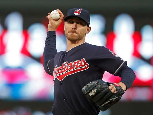Cleveland Indians pitcher Josh Tomlin throws to the Minnesota Twins during the first inning of a baseball game Tuesday, April 18, 2017, in Minneapolis. (AP Photo/Jim Mone)