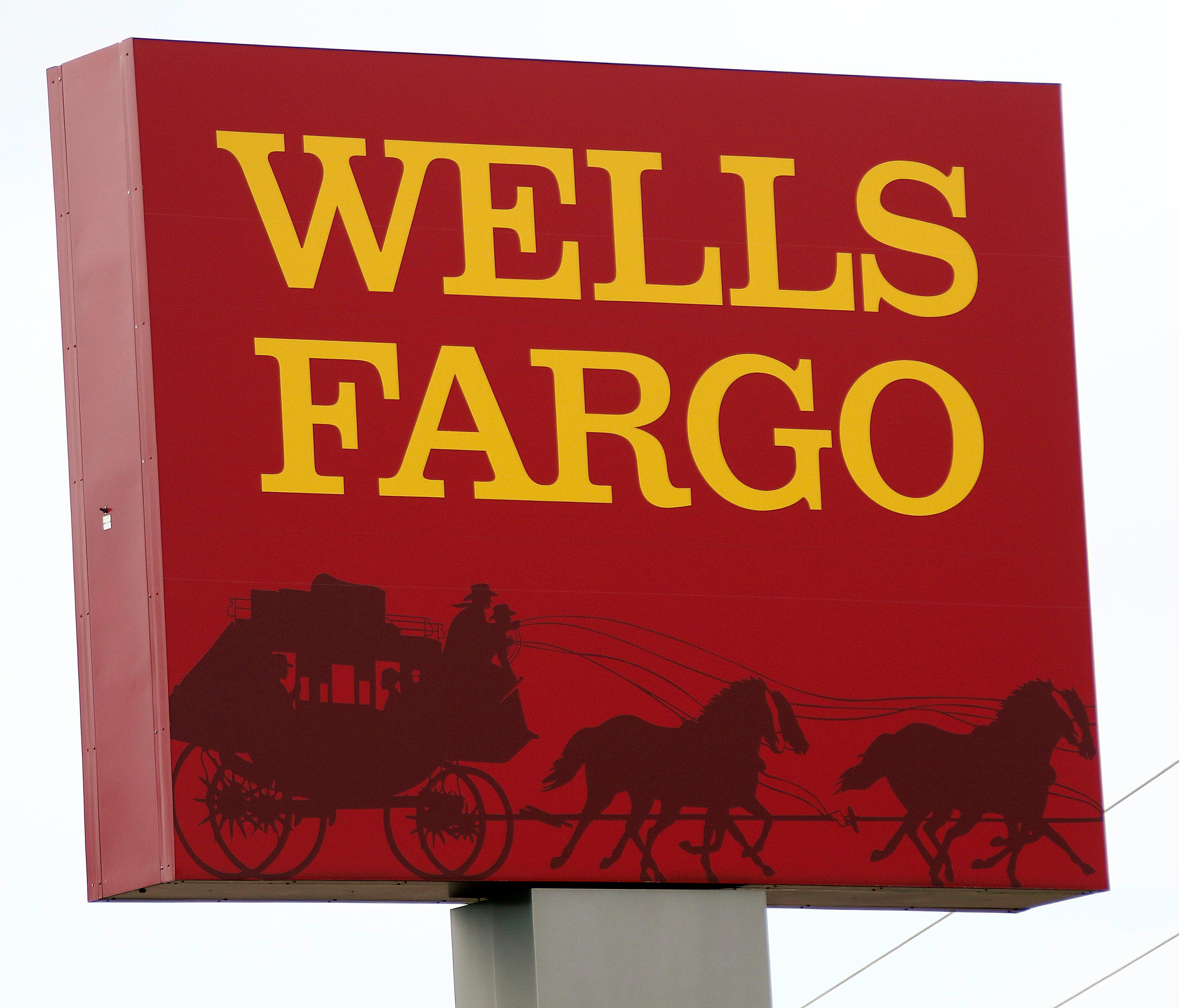 FILE - This April 11, 2017, photo shows a Wells Fargo bank in northeast Jackson, Miss. At least three lawsuits have now been filed against Wells Fargo from customers who say they were hurt by the bank's latest scandal, involving how it operated its a