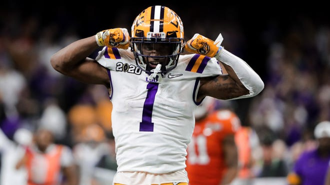 Jan 13, 2020; New Orleans, Louisiana, USA; LSU Tigers wide receiver Ja'Marr Chase (1) reacts after a first down catch and run against the Clemson Tigers in the College Football Playoff national championship game at Mercedes-Benz Superdome. Mandatory Credit: Derick E. Hingle-USA TODAY Sports