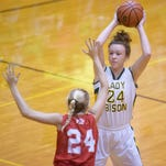 Benton Central's Katie Shields looks to pass to a teammate Thursday, December 10, 2015 at Benton Central High School. Benton Central was victorious over West Lafayette.