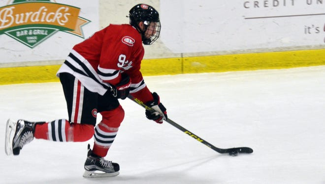 St. Cloud State's Joey Benik looks to shoot the puck in the first period Saturday in Kalamazoo, Michigan. Benik had a hat trick for the Huskies.