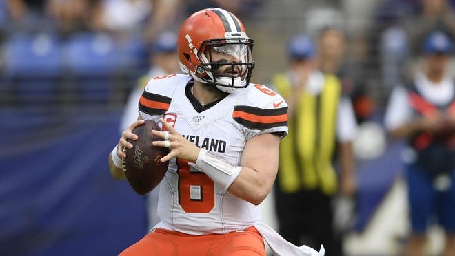 Browns quarterback Baker Mayfield ooks to pass during a game against the Baltimore Ravens last season.