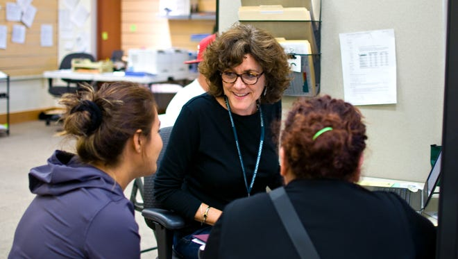 Volunteer Certified Application Counselor Gladys Poorte helps consumers with health care at the Insure Central Texas enrollment center in Austin.
