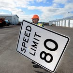 Carl Columbus from the Great Falls division of the Montana Department of Transportation shows off new 80 mile per hour speed limit sign for the states new speed limit, which will take effect on October 1.