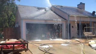 Firefighters had difficulty accessing Ahwatukee house on fire due to filled-to-capacity garage.