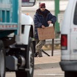 A man panhandles at the intersection of Timberline Road and Mulberry Road in this 2012 file photo. A federal judge vacated a Monday afternoon hearing that could have resulted in a preliminary injunction on the city's panhandling ordinance enforcement.
