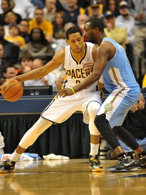 Indiana's Danny Granger works towards the basket against Denver's Jordan Hamilton in the fourth quarter as the Indiana Pacers defeated the Denver Nuggets 119-80 at Bankers Life Fieldhouse Monday February 10, 2014.