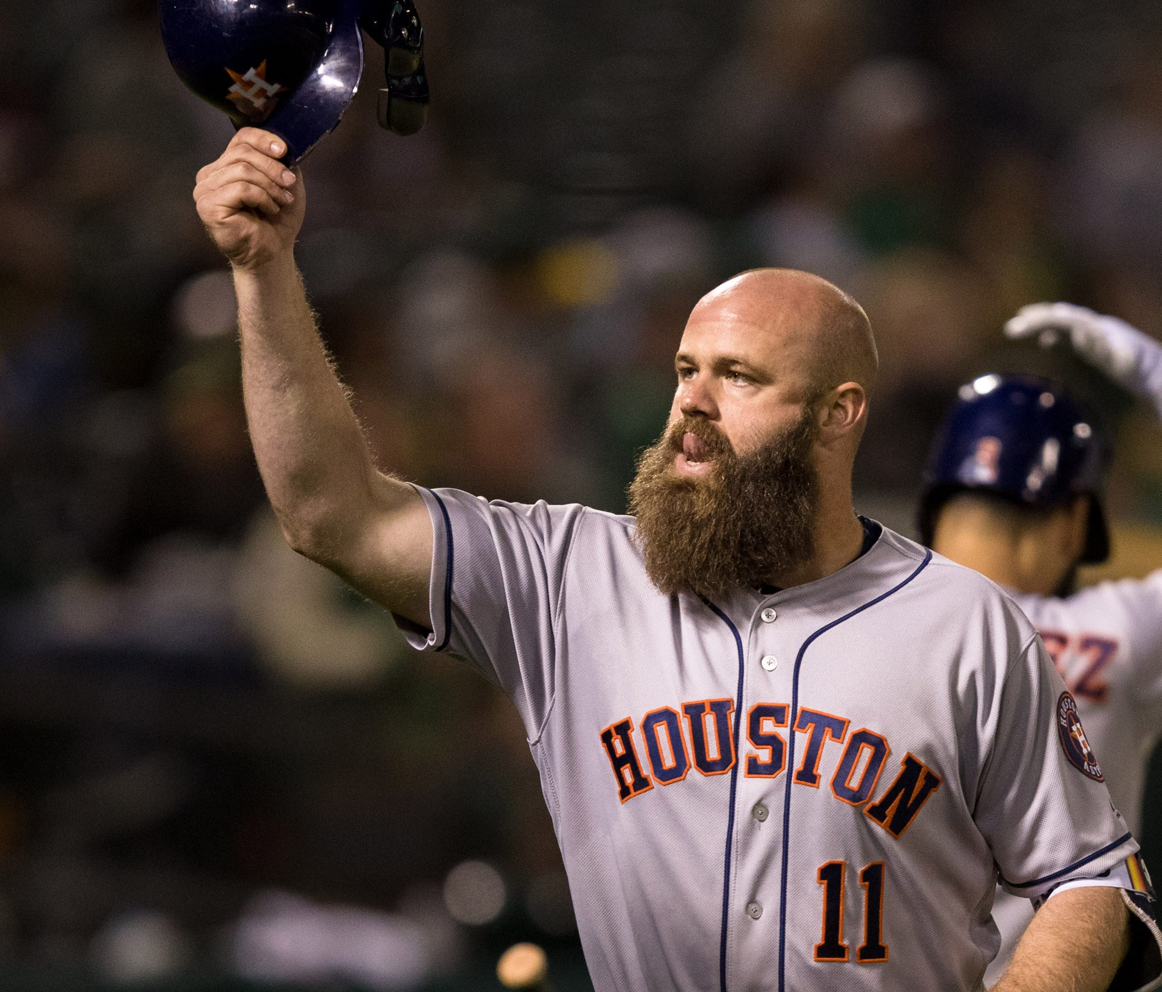 Evan Gattis reacts after hitting a solo home run.