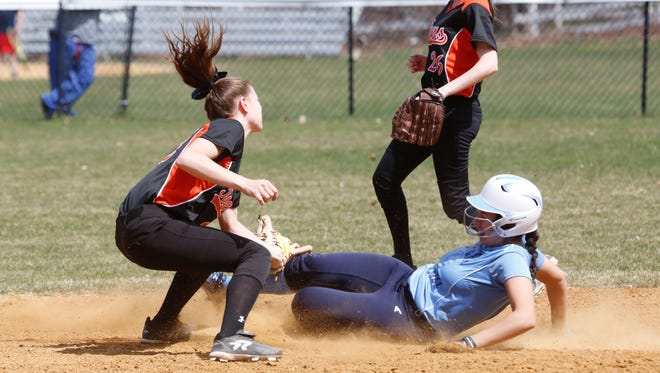 Mamaroneck's Tara Kasper (22) tries to tag out Suffern's Carina Luna (11) at 2nd base during the 2nd inning at Suffern on Apr. 10, 2017.