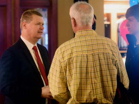 Sauk County Circuit Court Judge Michael Screnock (left) talks with a supporter Tuesday night at his party in the Wisconsin Dells. Screnock lost the state Supreme Court race to Milwaukee County Circuit Court Judge Rebecca Dallet.