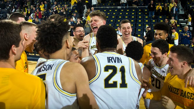 Michigan forward Moritz Wagner, center, celebrate with teammates after U-M's 82-70 win over Purdue Saturday at Crisler Center.