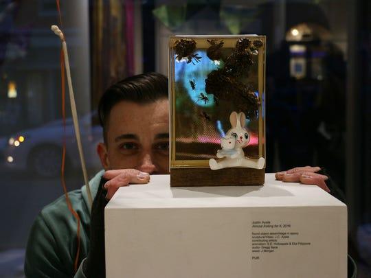 Justin Ayala, 37, of York Township, with his artwork