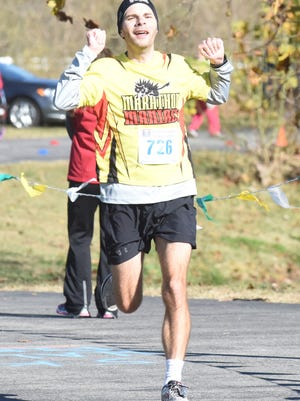 Eric Skaug of Jonesboro nears the finish line before winning the White River Marathon for Kenya last year in Cotter.