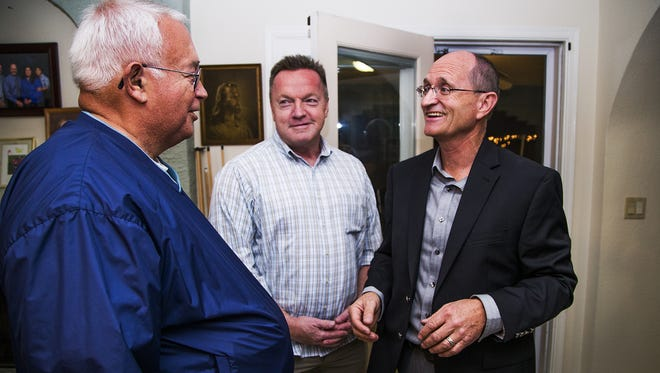 Ray Malnar, right, speaks with supporters David Beeson, left, and State Rep. Anthony Kern, Dist. 20, middle, at Malnar's election-night campaign event in Glendale, Tuesday night, November 3, 2015.
