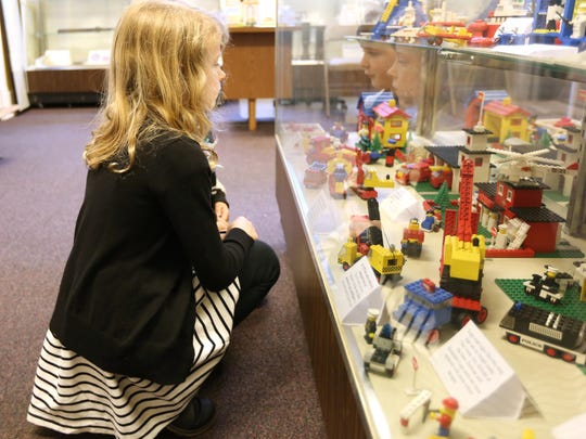Kate Jackson and cousin Bradyn Jackson look at the Lego exhibit on May 22 at the Keizer Heritage Museum.