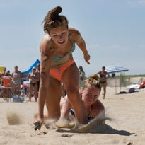 Bradley Beach's Kelly Smith beats out Monmouth County Park's MacKenzie Knox in the Division I Beach Flags competition at the All-Women Lifeguard Tournament at Sandy Hook.