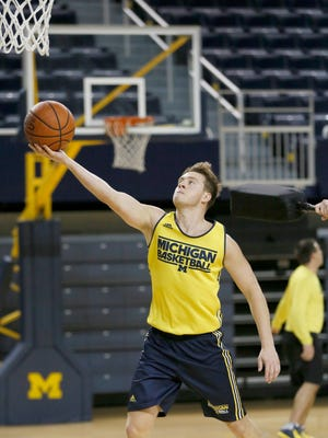 Michigan Spike Albrecht goes in fro a layup during a drill at basketball practice on Thursday, October 22, 2015, in Ann Arbor. Julian H. Gonzalez/Detroit Free Press