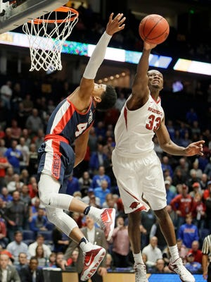 Arkansas forward Moses Kingsley (33) came up with a critical block of Ole Miss' Breein Tyree (4) in the final seconds.